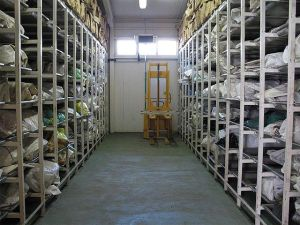 ICMP's Podrinje Identification Project (PIP) was formed to deal with the identification primarily of victims of 1995 Srebrenica massacre. PIP includes a facility for storing, processing, and handling exhumed remains. Much of the remains are only fragments or commingled body fragments since they were recovered from secondary mass graves. The photo depicts one section of the refrigerated mortuary.