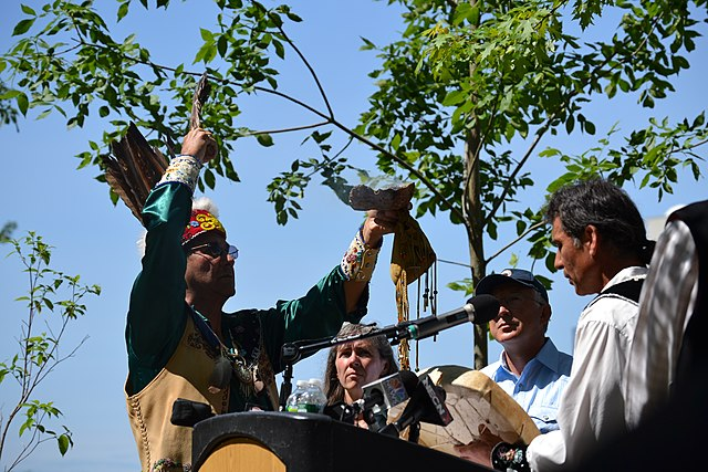 Butch Phillips and Barry Dana of the Penobscot Nation offer a blessing at the 2012 Penobscot River Restoration Project.